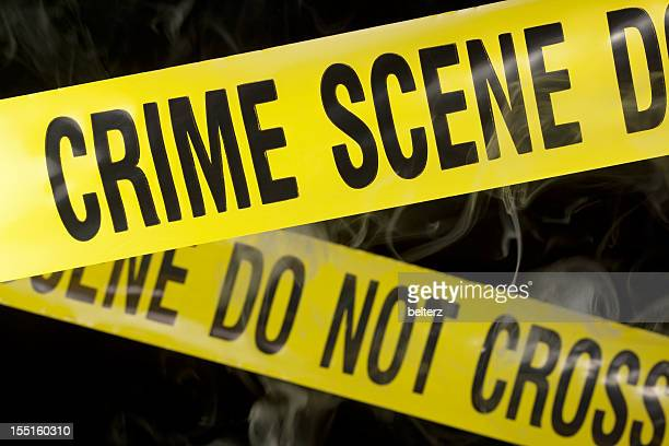 Close-up of yellow crime scene tape on black