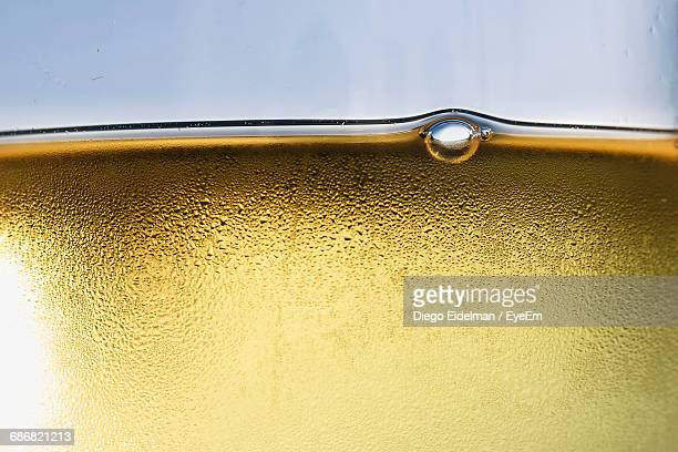 Close-Up Of Yellow Glass Of Water