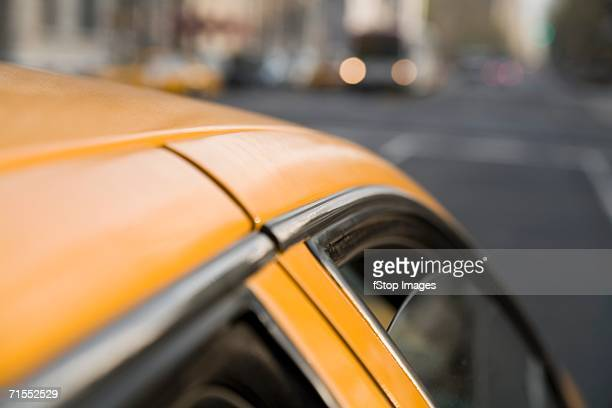 Close-up of yellow taxi, New York City
