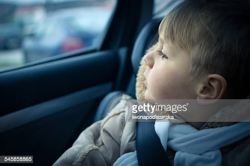 Close-up of young boy in car seat