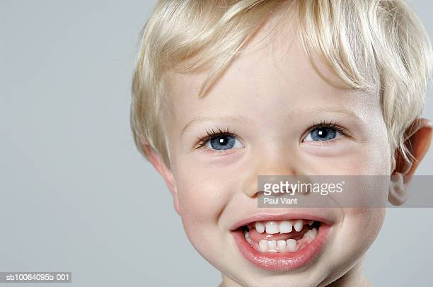 Close-up of young boy (2-3) smiling