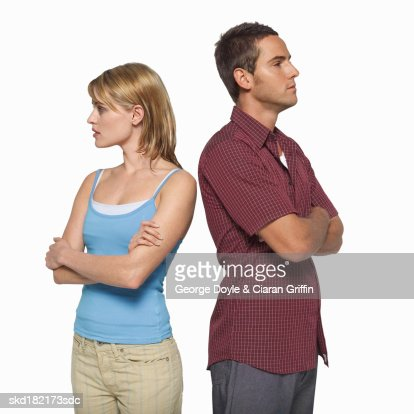 Close-up of young couple standing with arms crossed : Stock Photo