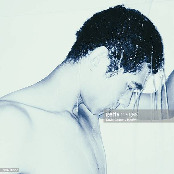 Close-Up Of Young Man In Shower