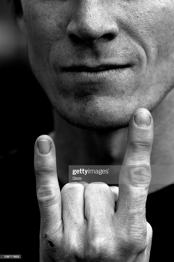 Close-up of Young Man Making Rock and Roll Gesture : Stock Photo