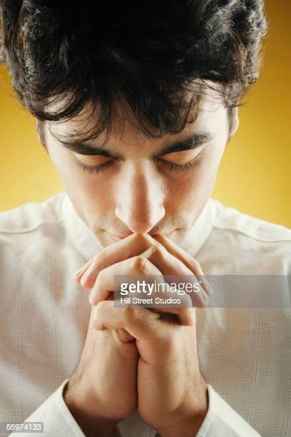 Closeup of young man praying