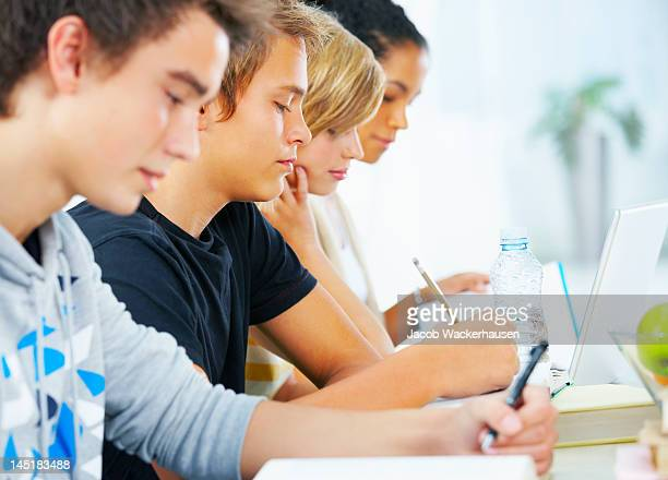 Close-up of young students paying attention