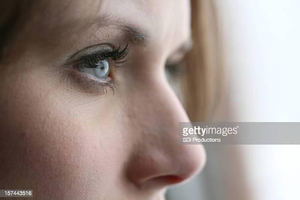 Closeup of Young Woman Gazing Away