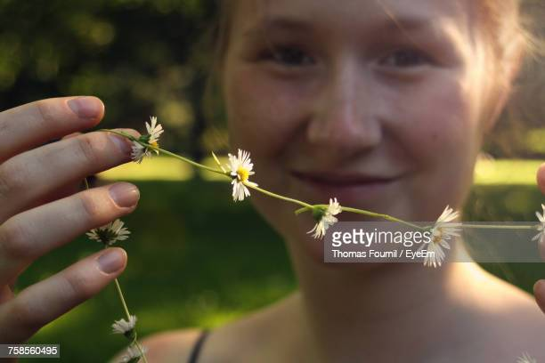 Close-Up Of Young Woman Holding Flower