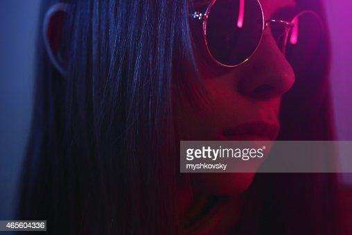 Close-up of young woman in sunglasses. (gel effect)