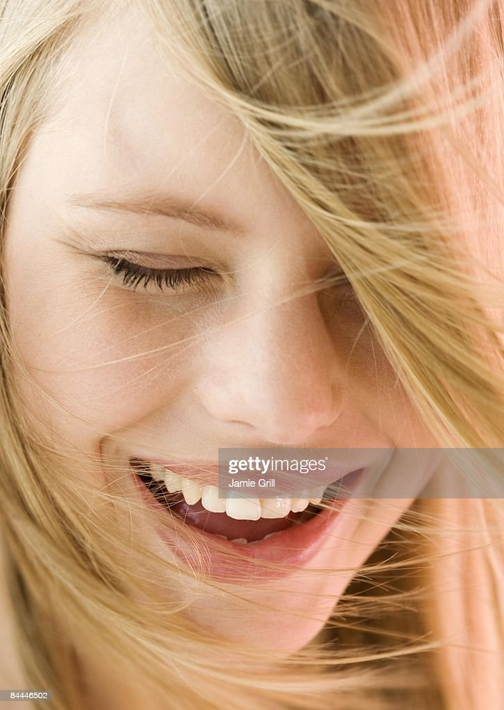 Close-up of Young Woman Laughing : Stock Photo