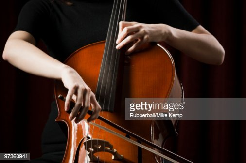 Close-up of young woman playing cello