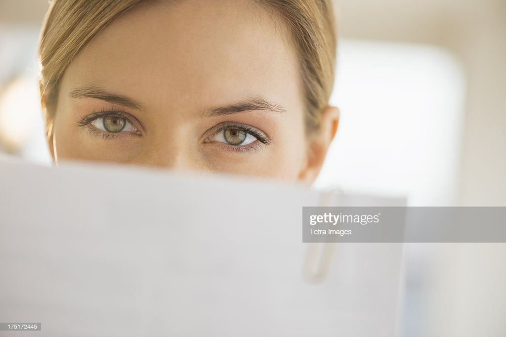 Close-up of young woman reading documents
