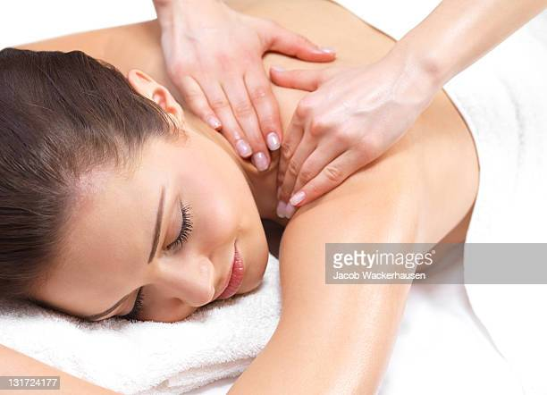Close-up of young woman receiving back massage