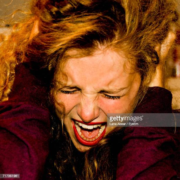 Close-Up Of Young Woman Scream