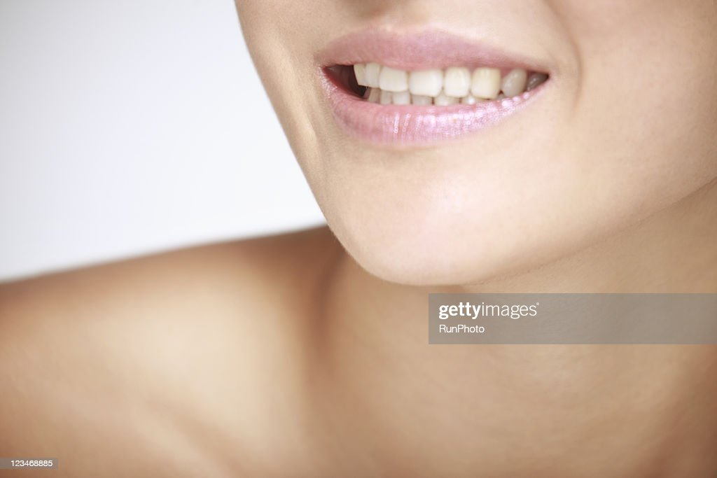 close-up of young woman smiling : Stock Photo