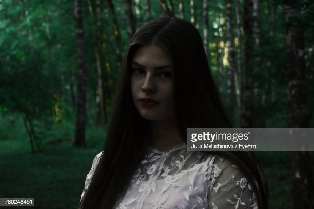Close-Up Of Young Woman Standing In Forest