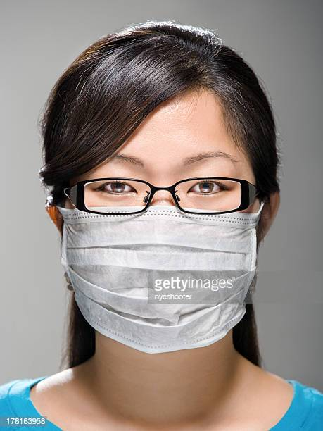 Close-up of Young woman wearing protective mask
