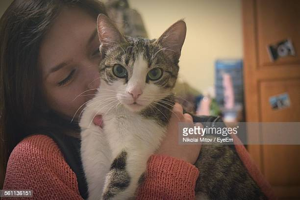 Close-Up Of Young Woman With Cat