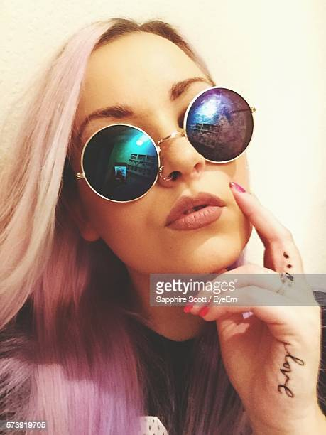 Close-Up Of Young Woman With Purple Hair Wearing Sunglasses