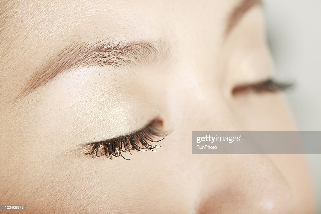 close-up of young woman's eyes,eyes closed : Stock Photo