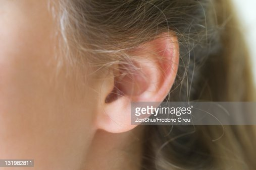 Close-up of young woman's pierced ear