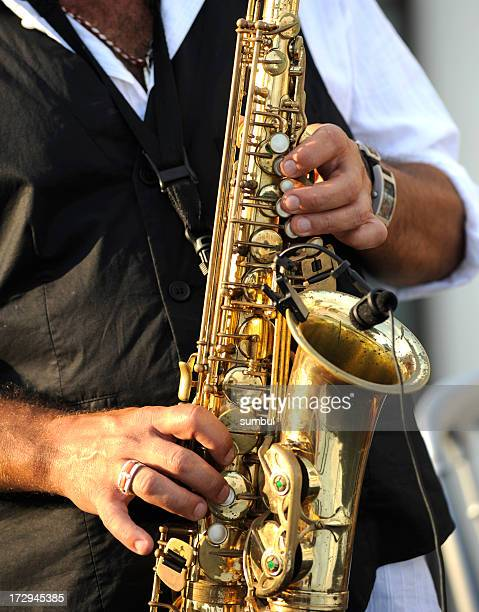 Close-up on hands playing a saxophone