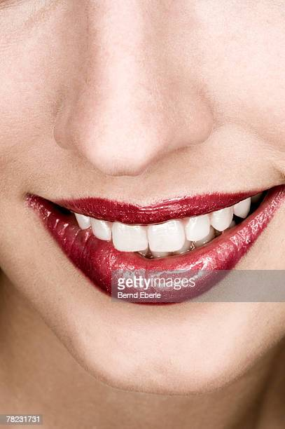 close-up on mouth of friendly smiling woman