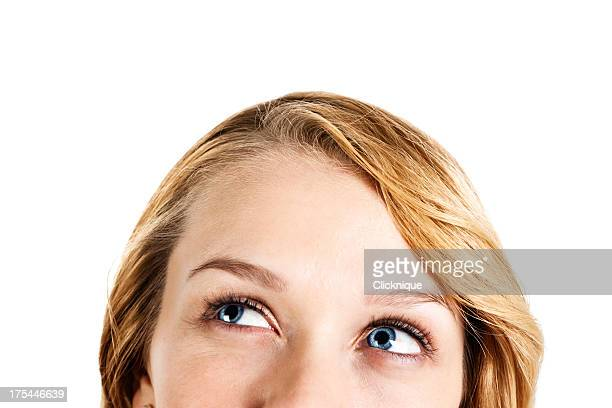Close-up on pretty blonde with smiling eyes looking sideways