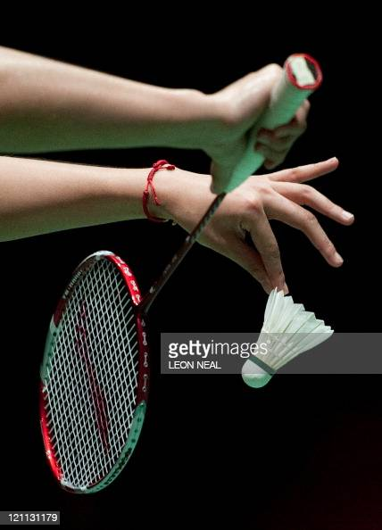 A closeup on the hands of Tian Qing of China as she serves a shot to Wang Xiaoli and Yu Yang of China during the Finals of the women's doubles at the...