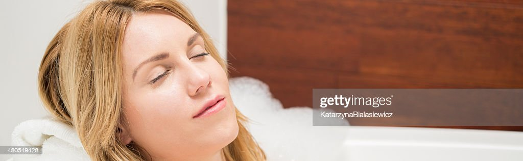 Close-up on woman resting in bathtub : Stock Photo