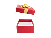 open and empty red gift box with gold ribbon bow isolated on white background, surprise in holiday event