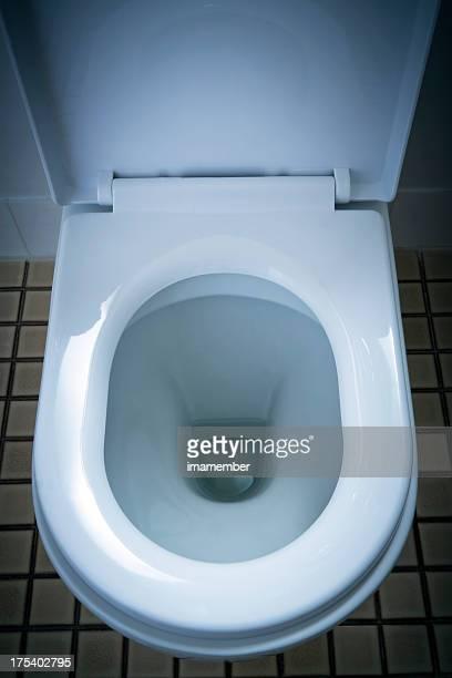 Closeup open household white porcelain toilet