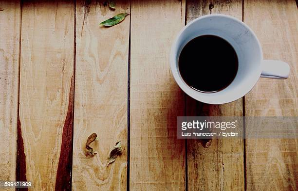 Close-Up Overhead View Of Coffee On Wooden Table