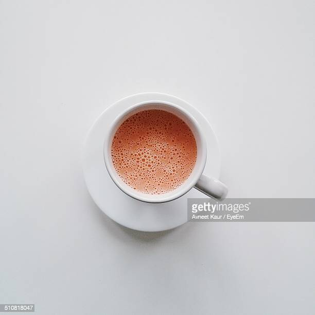 Close-up overhead view of coffee over white background