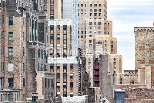 Closeup Pattern Of Old Vintage Brick Skyscraper Buildings