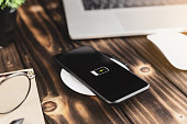 close-up phone charging on wireless charger device