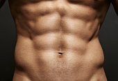 Young muscular athlete with perfect abs