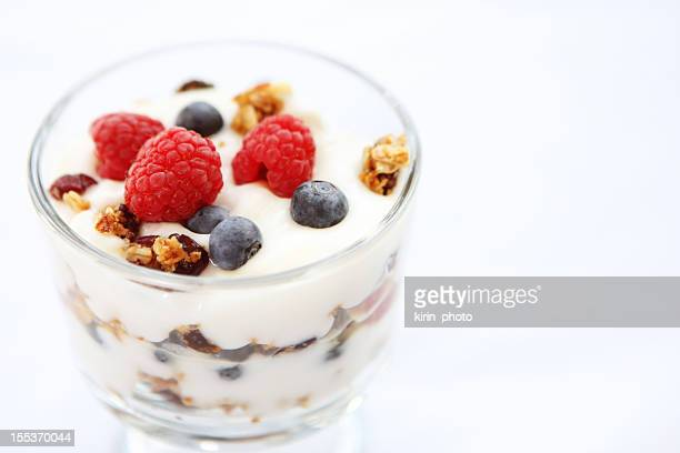 Close-up photo of breakfast berry yogurt parfait w/ granola