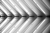 Roof structure. Lath ceiling. Joist, rafter. Abstract black and white photo of contemporary architecture or interior fragment / detail. Geometric pattern with regular angular structure.