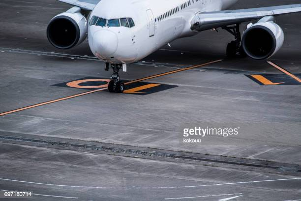 Close-up photograph of an airplane stopped at the airport.