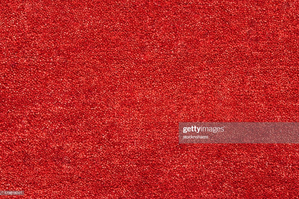 A closeup picture of a clean and bright red carpet : Stock Photo
