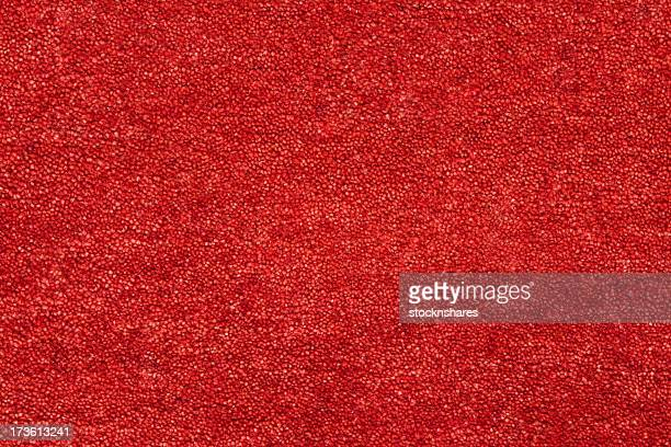A closeup picture of a clean and bright red carpet
