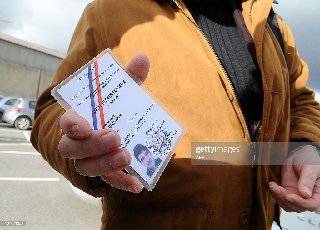 A close-up picture shows Michel Martin Fraud controllers of French Directorate General for Competition, Consumer Affairs and Repression of Fraud (DGCCRF) professional card, as he controls the French meat supplier Spanghero's headquarters on February 11, 2013 in Castelnaudary, southern France. The Europe-wide scandal over horsemeat sold as beef spread on February 10 as leading French retailers pulled products from their shelves and threats of legal action flew. The suspect lasagne meals sold by Swedish frozen food giant Findus in Britain were made by French company Comigel using meat supplied by French meat-processing firm Spanghero. Aguerre declared that Spanghero respected the law.