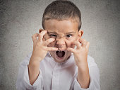 Closeup portrait angry child, Boy Screaming hysterical demanding, having nervous breakdown isolated grey wall background. Negative human Emotion Facial Expressions, body language, attitude, perception