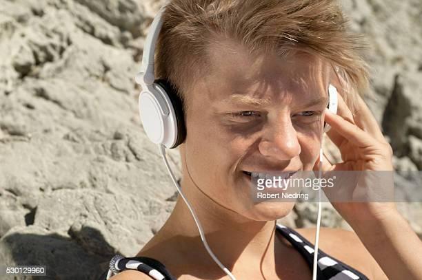 Close-up portrait male teenager headphones music