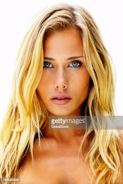 Closeup portrait of a cute blond woman against white