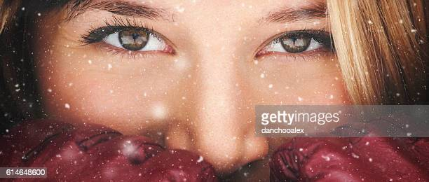 Closeup portrait of a girl while snowing