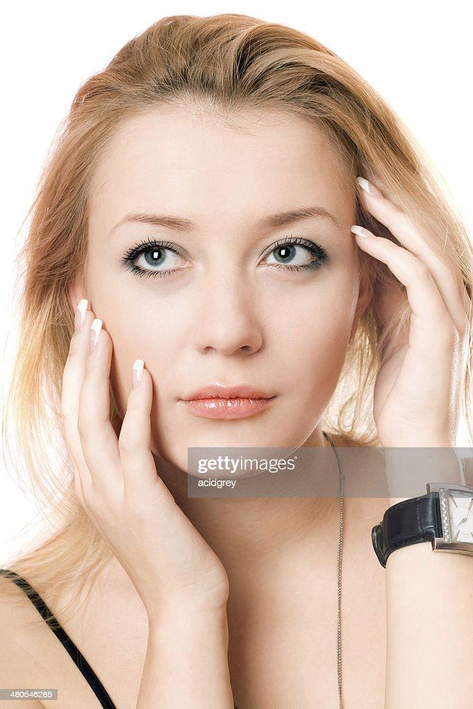 Closeup portrait of a pensive blonde : Stock Photo