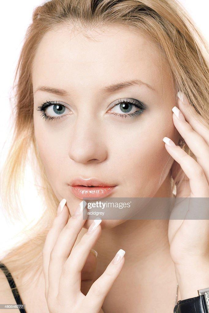 Closeup portrait of a playful beautiful blonde : Stock Photo