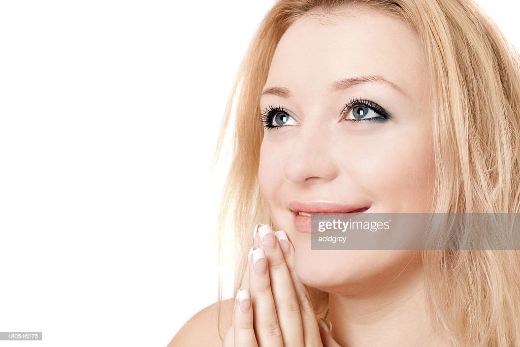 Closeup portrait of a smiling blonde : Stock Photo
